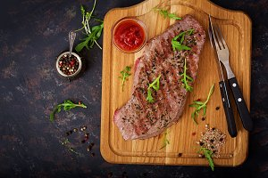 Juicy steak rare beef with spices