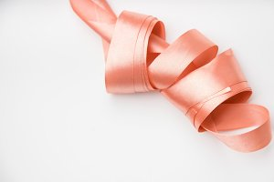 Coil of pink silk ribbon