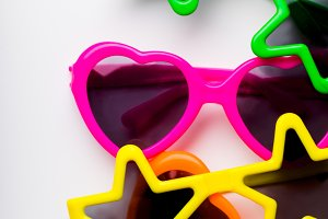 Children's sunglasses in bright colors and various forms