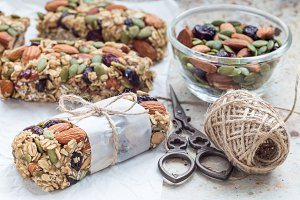 Homemade granola energy bars with figs, oatmeal, almond, dry cranberry and pumpkin seeds, horizontal