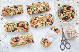 Homemade granola energy bars with figs, oatmeal, almond, dry cranberry and pumpkin seeds, top view