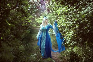 Young woman elf standing in a fairy
