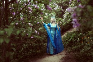 Young elf woman walks in a fairy for