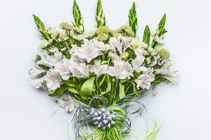 Festive flowers bouquet with bow
