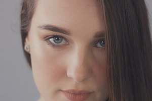 closeup of blue eyes of young woman