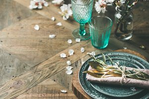 Spring Easter Table setting over vintage wooden background, square crop