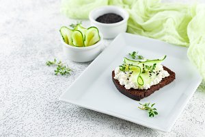 Toasts with ricotta, cucumber and black sesame