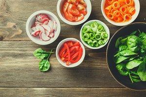Fresh vegetables in salad bowls