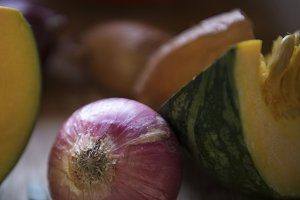 Close up of red onion and pumpkin