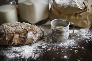 Flour and bread on a messy kitchen