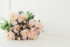 Vintage peony bouquet on white table