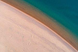 Beach and Calm Sea. Aerial Vertical Top-Down View