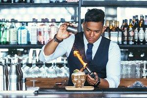 Expert barman using a blowtorch