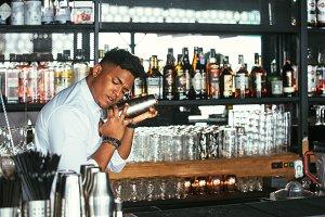 Bartender shaking a cocktail