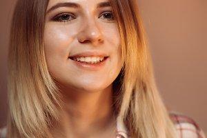 portrait smiling girl on orange background in studio