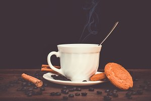 CUP OF COFFEE WITH PASTRIES