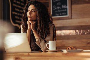 Freelancer woman sitting at a cafe