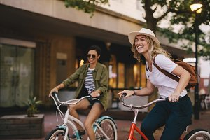 Female friends enjoying bicycle ride