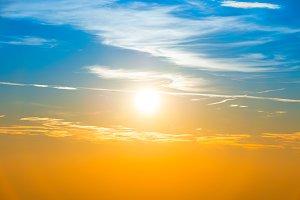 Sunset in sky with blue orange cloud