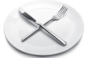 White empty plate with fork and knif