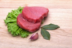 raw meat and lettuce leaf
