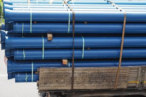 blue pipes on lorry