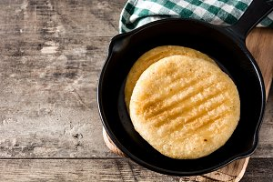 Arepas in frying pan