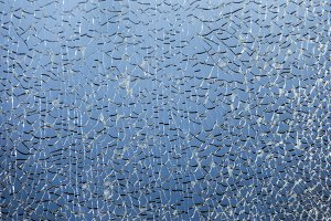 Close-up of abstract shattered broken glass texture