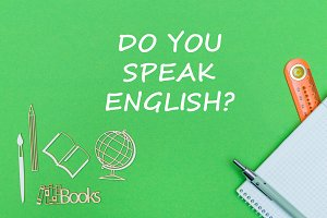 text do you speak english, school supplies wooden miniatures, notebook on green background