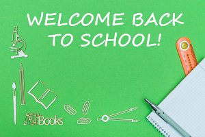 text welcome back to school, school supplies wooden miniatures, notebook with ruler, pen on green backboard