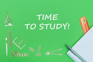 text time to study, school supplies wooden miniatures, notebook with ruler, pen on green backboard