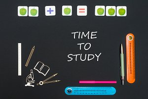 Above stationery supplies and text time to study on blackboard