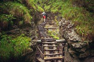Hiker walking hard way through the canyon