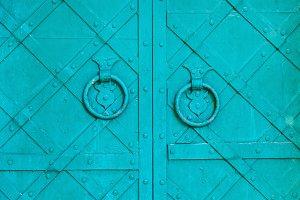 Old door aged metal door handle in the form of ring