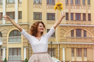 girl with a bouquet of yellow Gerbera flowers
