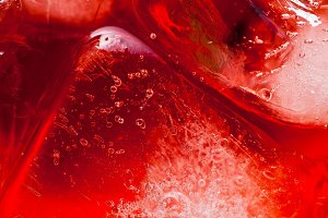 closeup photo of raspberries drink with ice . red macro food bac