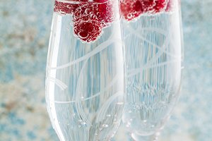 refreshing drink with raspberries in champagne glasses and fresh
