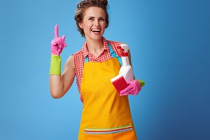 housewife with kitchen sponge and a bottle of detergent got idea
