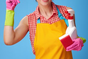 woman with kitchen sponge and a bottle of detergent got idea