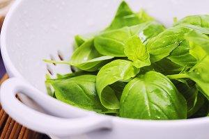 basil in colander and ingredients