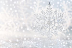 Christmas background with snowflake and shiny snow. New Year background with space for text.