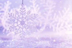 Light purple background with snowflakes. Christmas background.