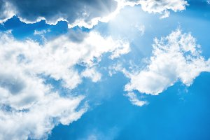 White fluffy clouds on the blue sky
