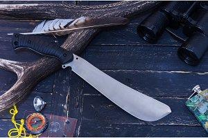 Knife hunter. Machete on the background of the horn.