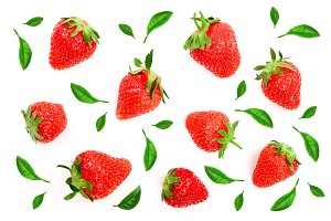 Strawberries decorated with green leaves isolated on white background. Top view. Flat lay pattern