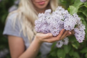 beautiful girl holding a lilac