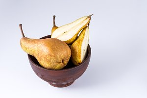 Pears in a clay plate. Fruits in a plate.