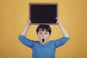 surprised boy with a blackboard
