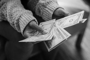 Closeup of woman counting money