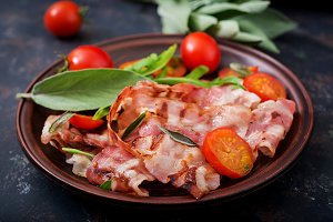 Fried bacon and tomatoes